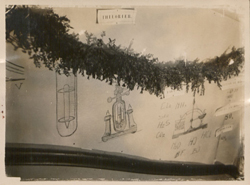 Drawings and garland over stairway at Kamerlingh Onnes Laboratory.