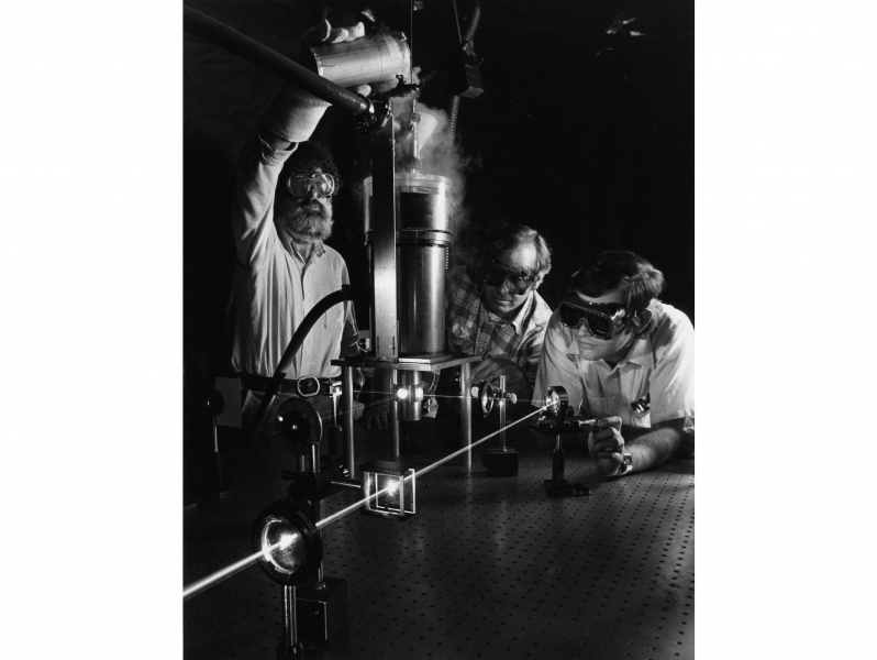Roger Macfarlane pours liquid nitrogen into the outer shielding chamber.