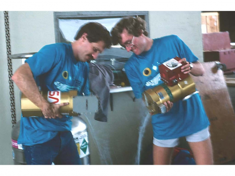 Tom Roellig and Greg Kopp emptying liquid nitrogen from the detector dewars prior to cooling them with liquid helium.