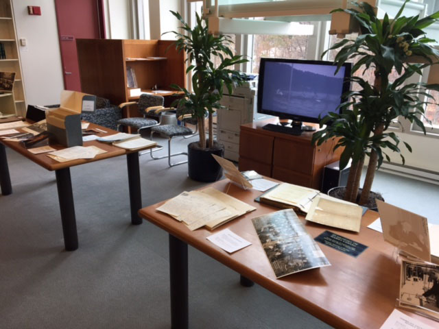 "Two tables of Member Society ""Treasures from the Archives"" display in reading room."