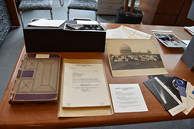 "Close-up of American Astronomical Society (AAS) portion of exhibit with handwritten meeting notebook, ""crank mail"" file, pamphlets, and photograph of 1922 annual meeting at Yerkes Observatory."