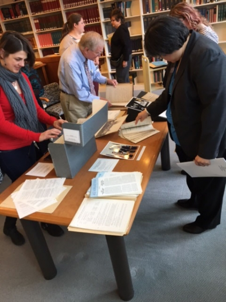 Member Society representatives and staff looking at their society's historical documents.