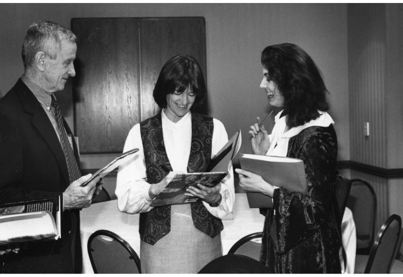Robert Park, Sally Ride, and Jennifer Oullette converse with books in hand.
