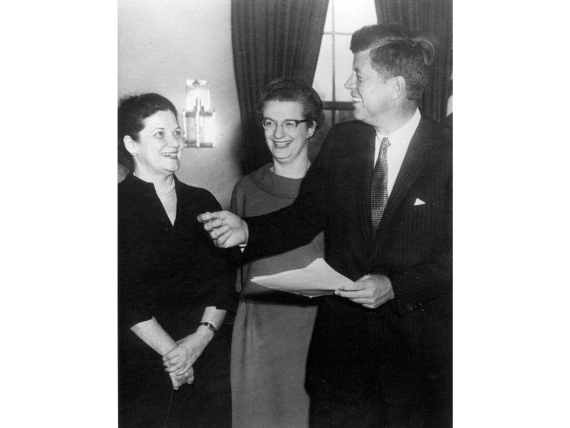 Nancy Grace Roman poses with President John F. Kennedy and Evelyn Harrison.