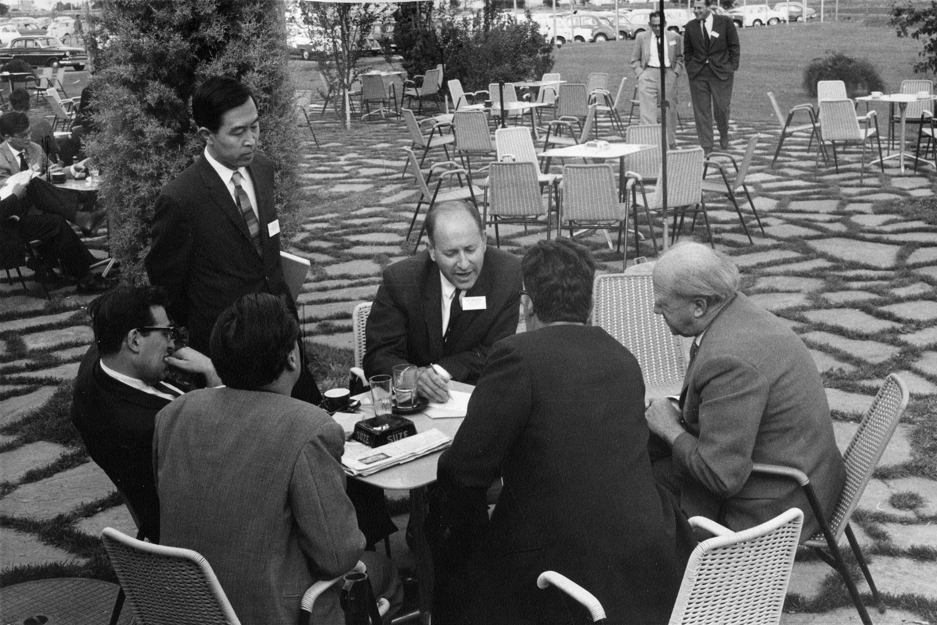 Candid group photo of Yoichiro Nambu, Julian Schwinger, Robert E. Marshak, Werner Heisenberg, and others