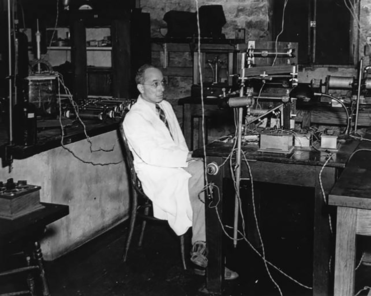 Portrait of Elmer Imes working in a laboratory
