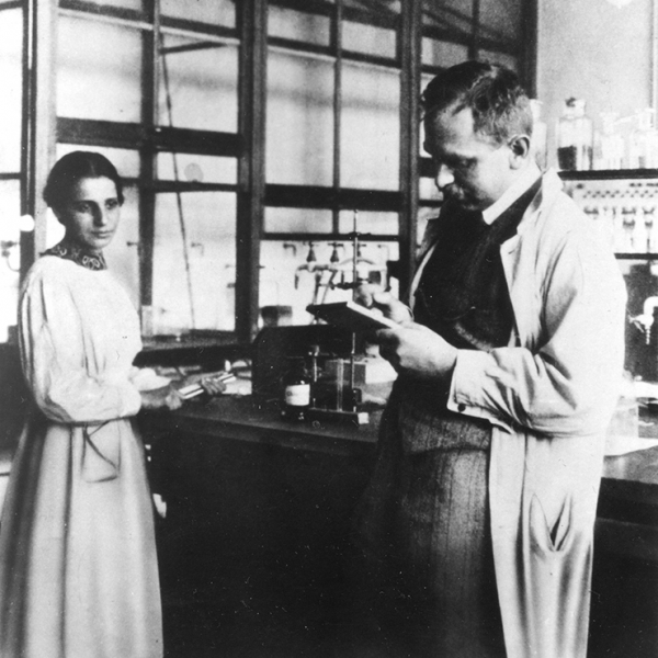 Lise Meitner and Otto Hahn working with equipment in their laboratory at the Kaiser Wilhelm Institute in Dahlem, Berlin, Germany.