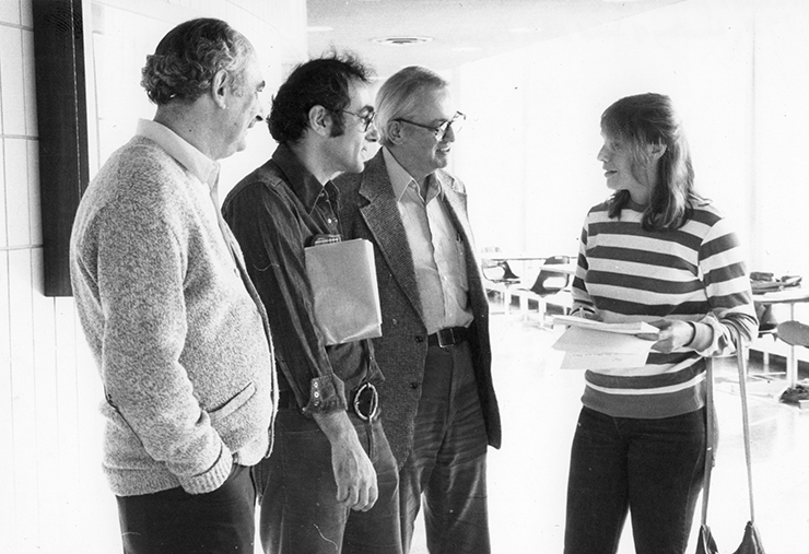 L-R: Andrew Granato, Gordon Baym, Charles Slichter, and Lillian Hoddeson converse at the History Solid State Physics Meeting.