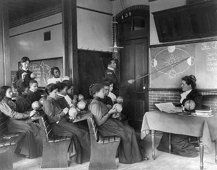 A Class in Mathematical geography at Hampton Institute studying the earth's rotation around the Sun. Hampton, Virginia, ca 1899.