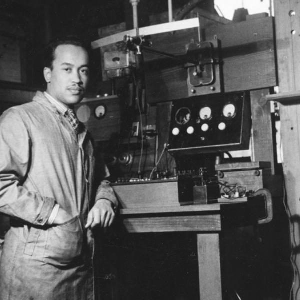 Herman Branson in laboratory with equipment.