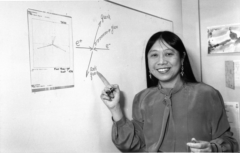Portrait of Sau Lan Wu pointing to a chart, circa 1989.