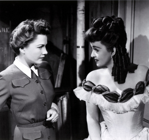 In All About Eve, actress Eve Harrington, Anne Baxter, left, secretly and deviously works to supplant her mentor, actress Margo Channing, Bette Davis, right. The 1950 movie won six Academy Awards, including Best Picture. CREDIT: 20th Century Fox